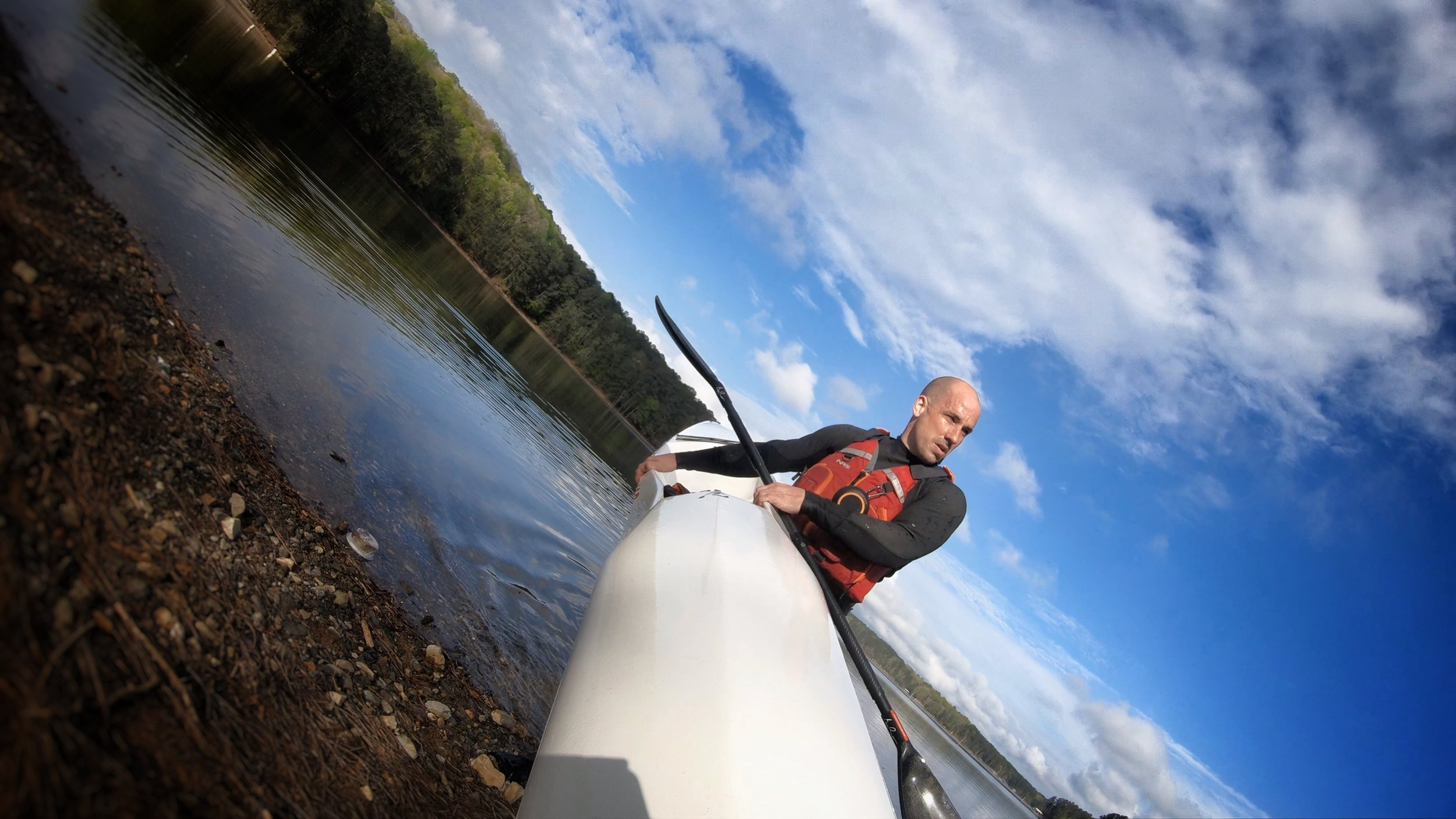 Joshua Carrying the V10 Surfski