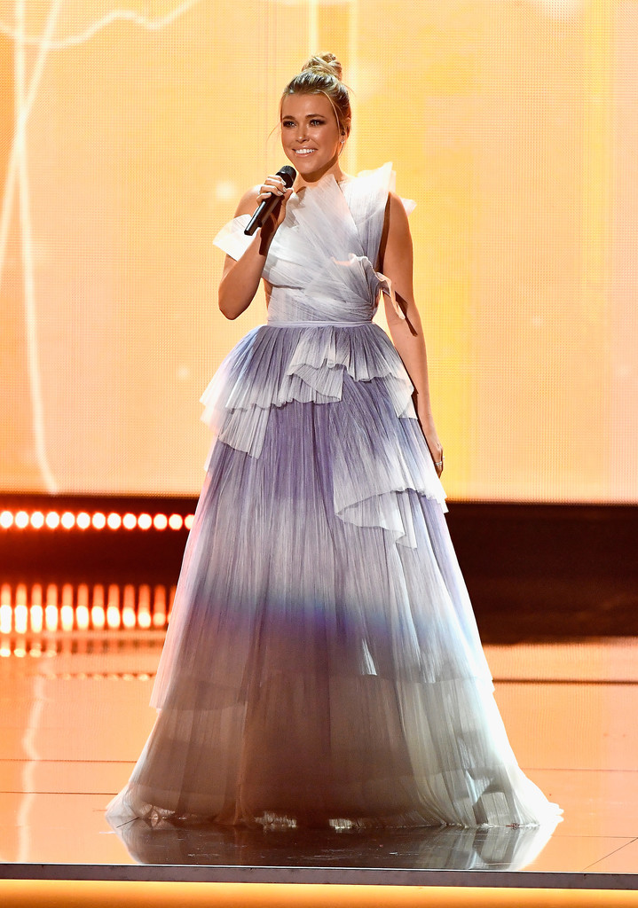 Rachel Platten on stage at the Miss Universe Pageant