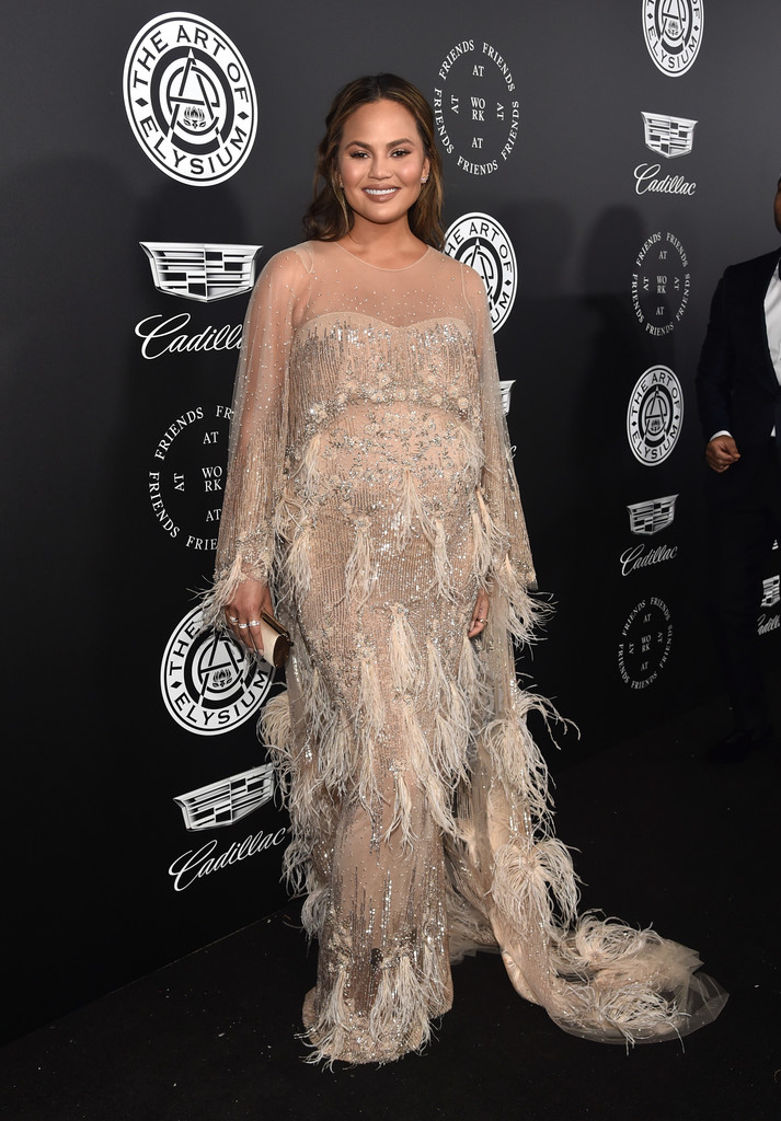 Chrissy Teigen attends The Art Of Elysium's 11th Annual Celebration