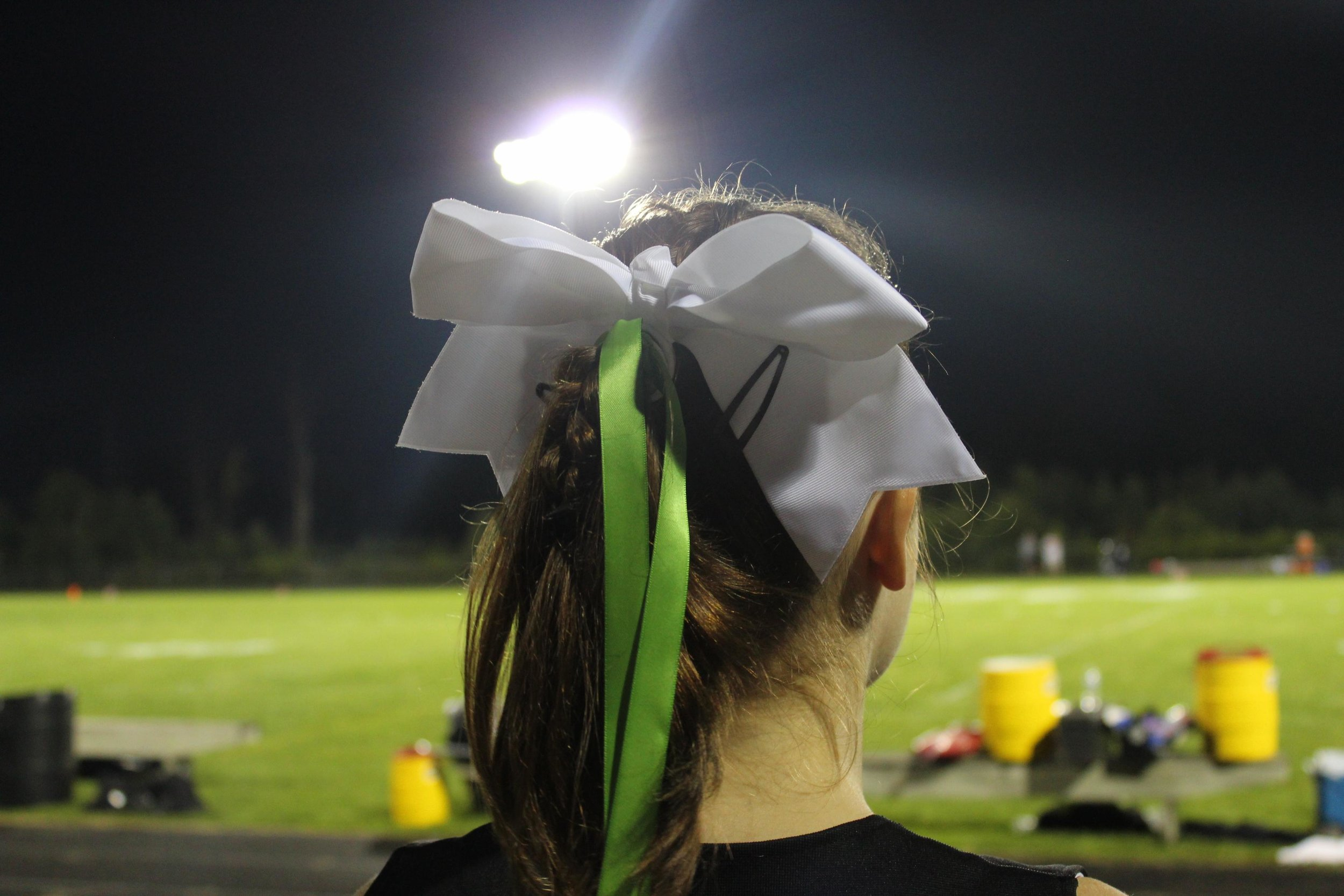 The Cheer Dance Team members are wearing green ribbons for every game this year, in support of Tommy and the Donate Life America Blue & Green cause.