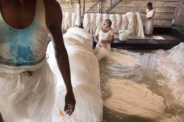 Creator// XAVIER ZIMBARDO/GETTY  The inside of a textile factory.