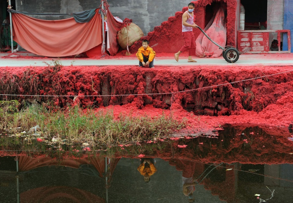 "Creator// YINXP  A river in Wangli. East China, within the Zhejiang province is known as the ""Red River."" You can see the pollution from concerning amounts of red dye used in the nearby factory. October 31, 2011// CGTN America"