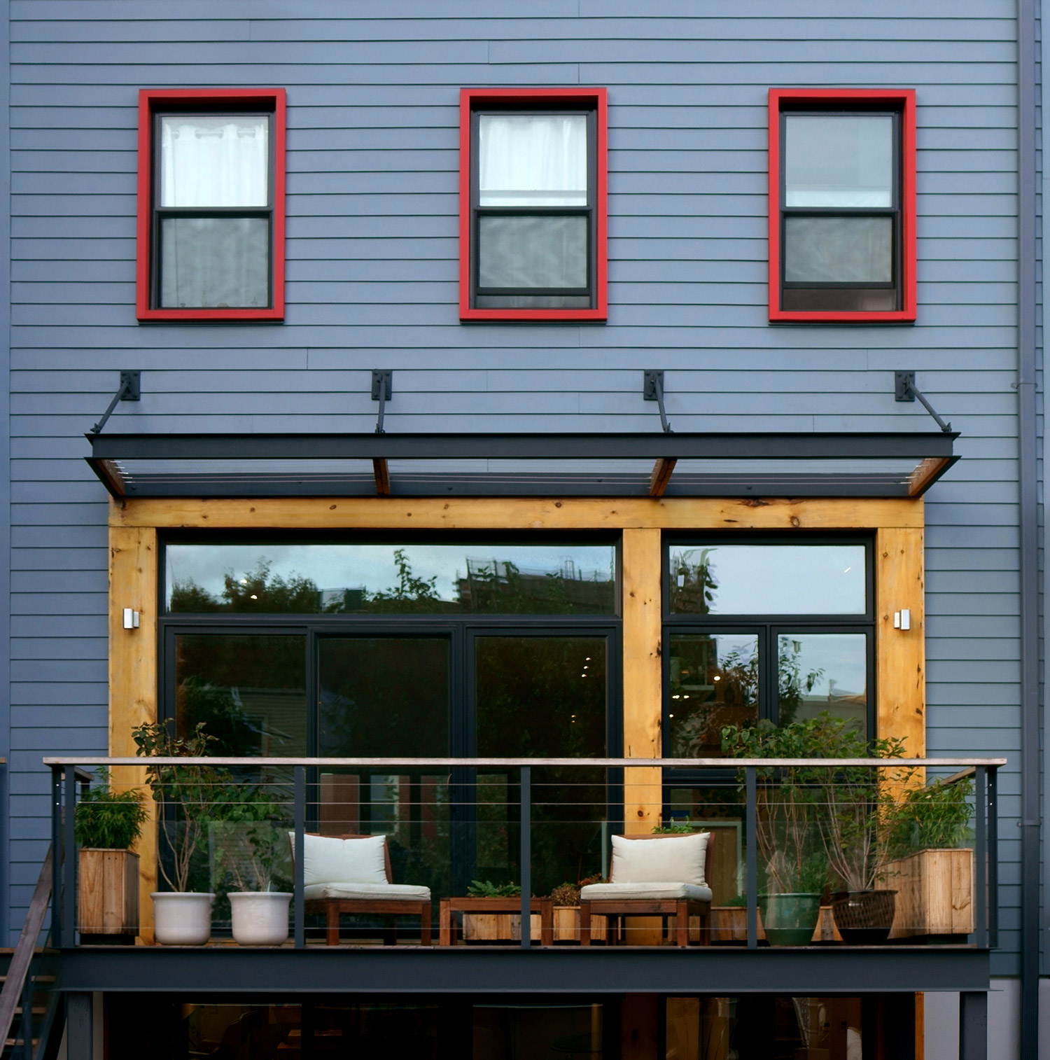 Brooklyn Townhouse Renovation - Red Window Frames at Rear Wall and Steel & Wood Deck