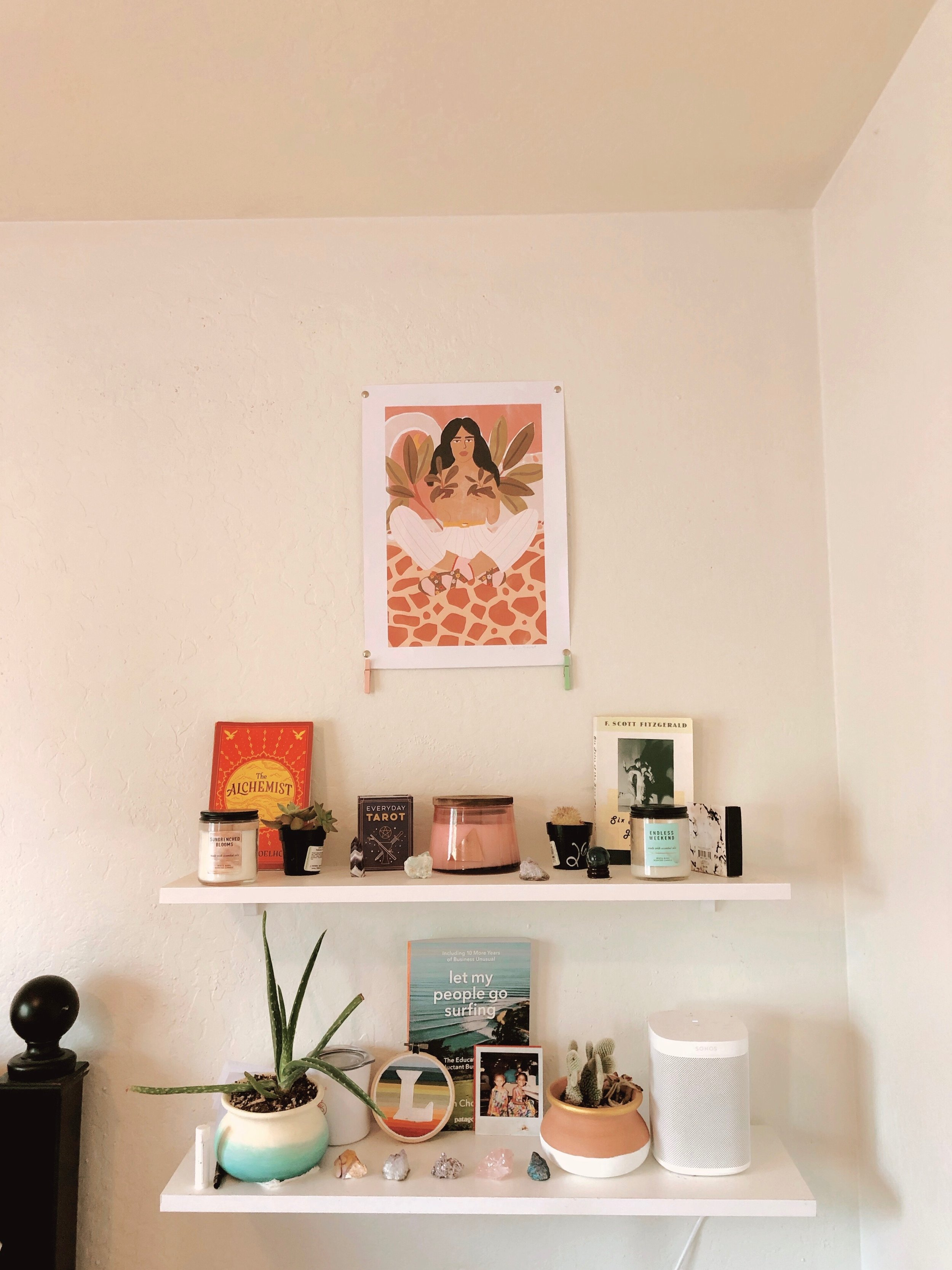 My  slightly crookedly hung  Crazy Plant Lady print next to my bed and on top of my crystal collection.