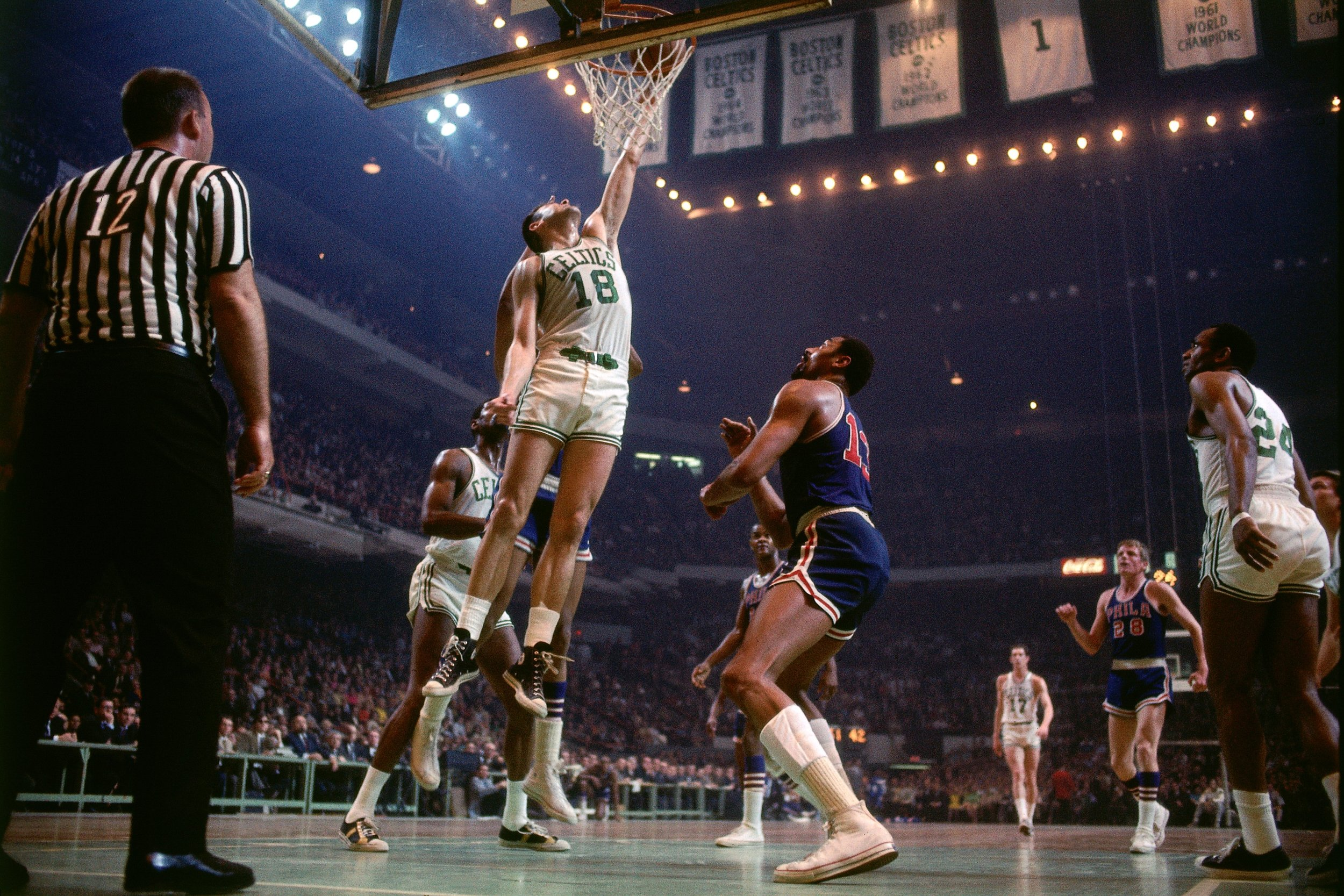 Howell cramming one and Wilt Chamberlain gets a front row seat.