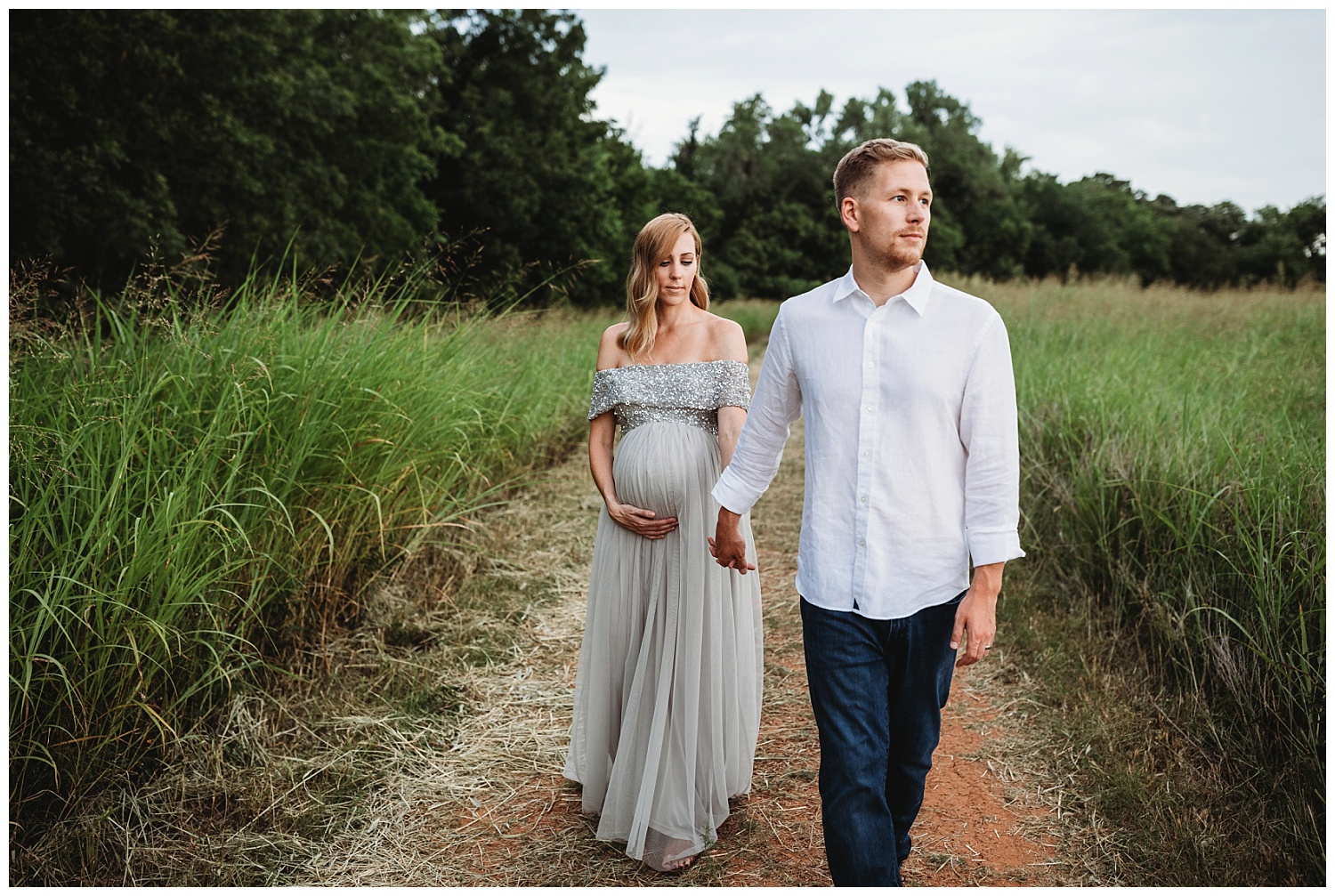 Maternity Photons in a field at Martin Nature Park in Edmond, Oklahoma. Sweet Couple holding hands.