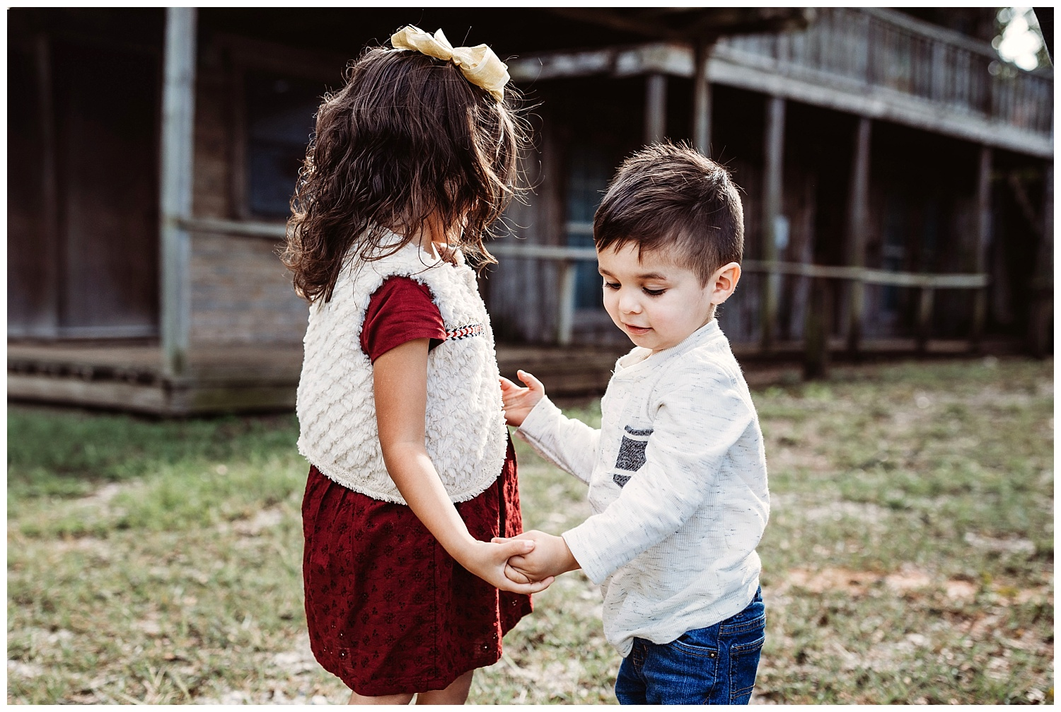 Brother and Sister holding hands, lifestyle family photography. Outdoor family photo shoot in Arcadia, OK.
