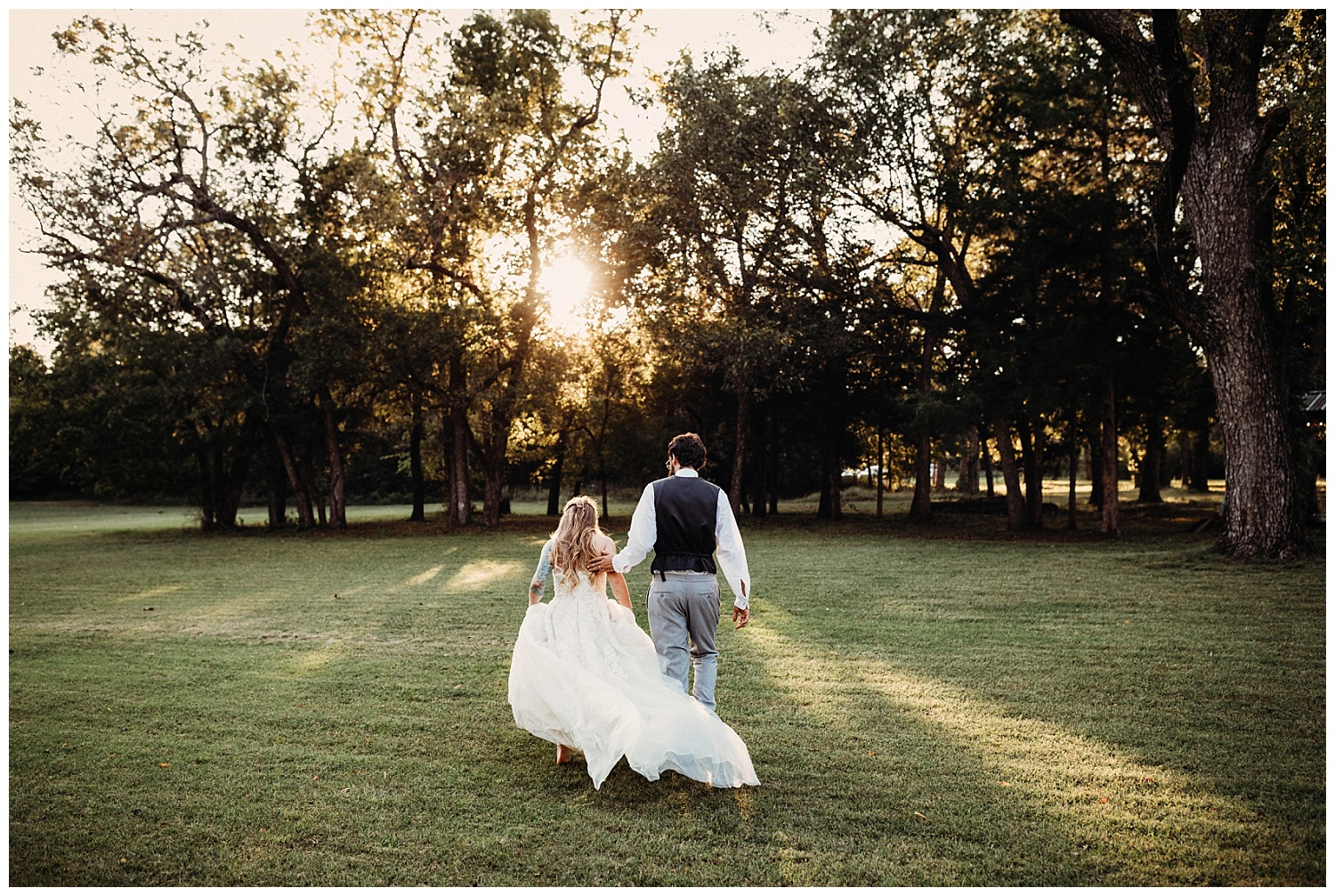 Bride and Groom walking in tress at Golden Hour on their wedding day.