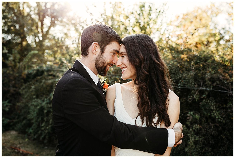 Sweet Photo of Jon and Molly hugging before the wedding. Oklahoma Wedding Photographer.