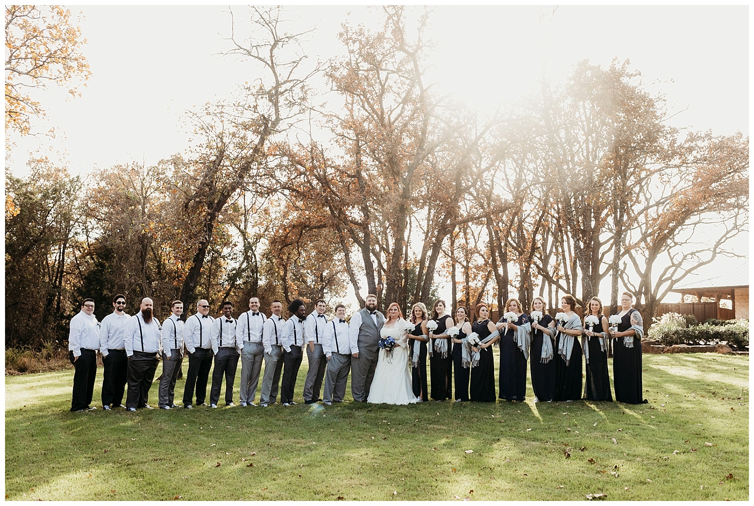 Large Bridal Party with 22 people outside at sunset at The Springs in Blanchard, Oklahoma.