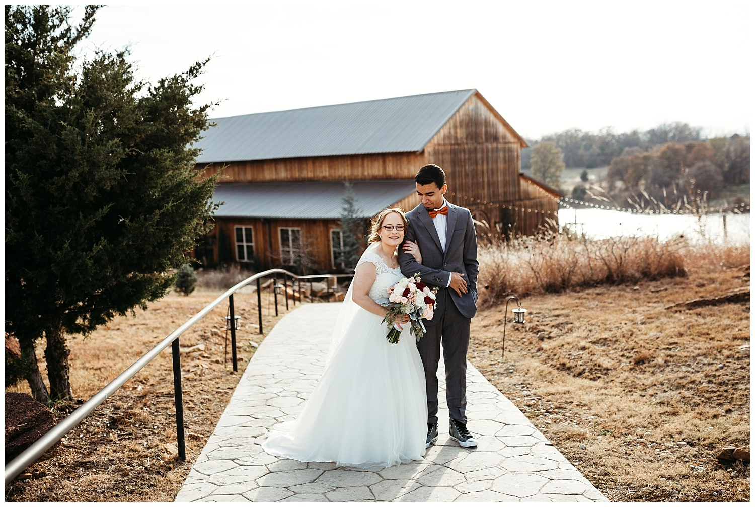 Wedding couple photos in front of the Barn at Rosemary Ridge.
