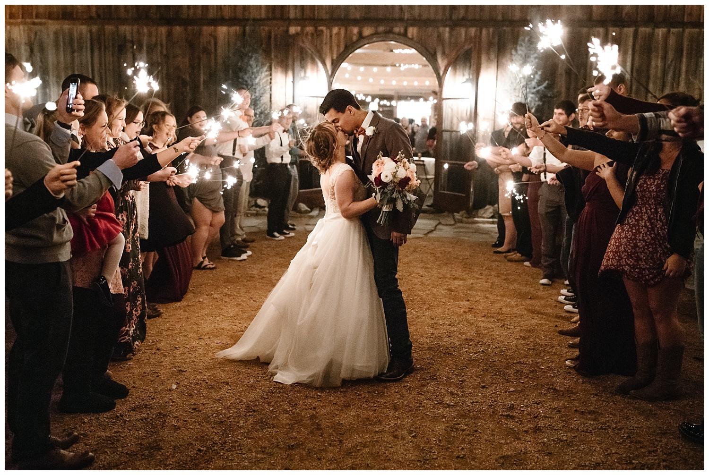 Sparkler exit kiss at Rosemary Ridge in Stillwater, Oklahoma.