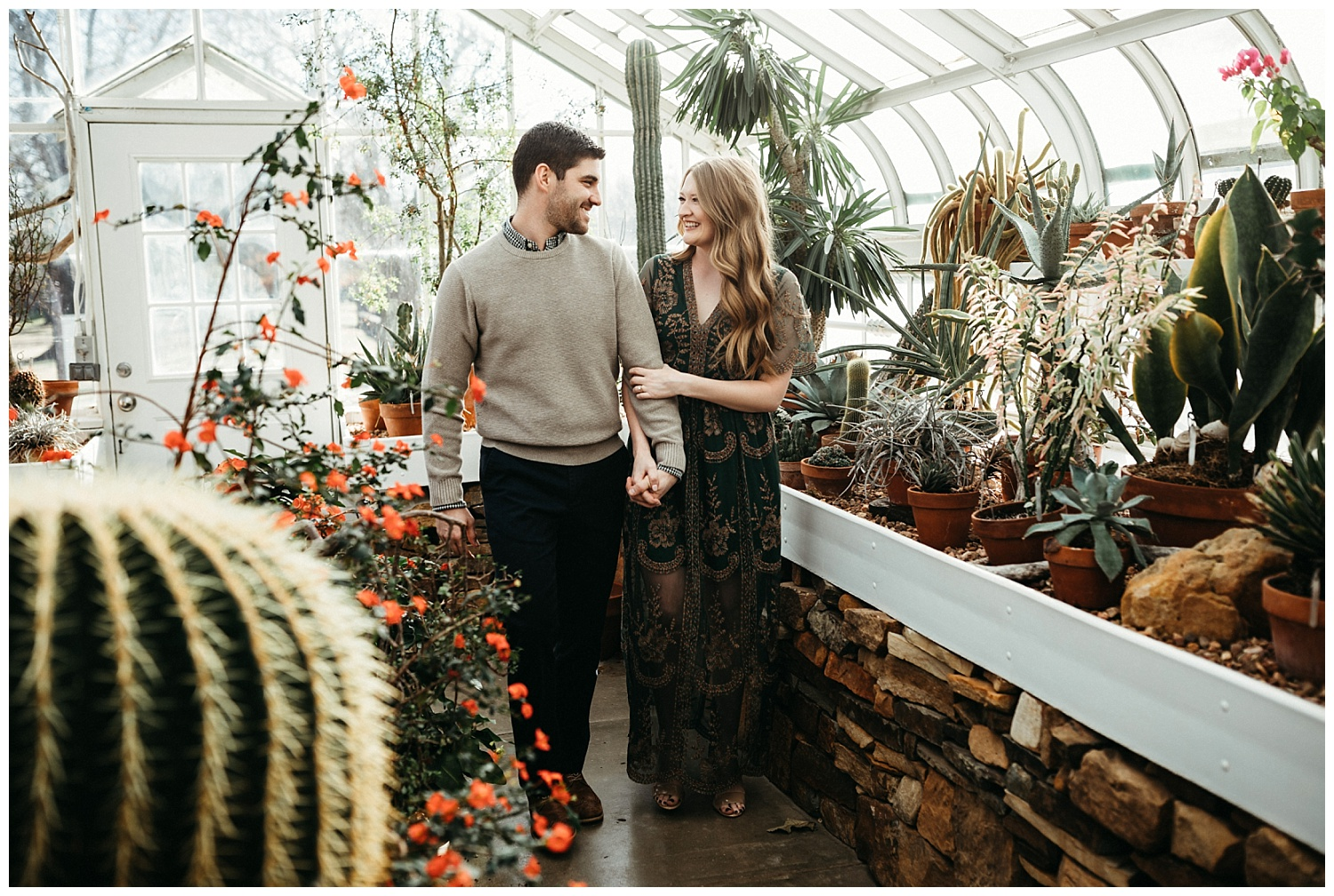 Beautiful couple walking through the cactus plants at the conservatory greenhouse in Tulsa, OK.