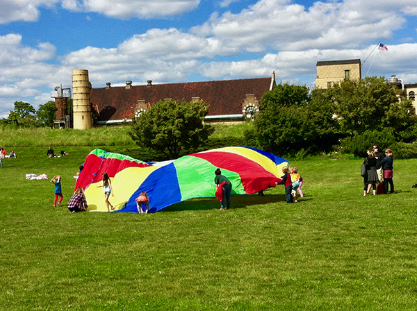 Park visitors gather for a parachute game at the Garfield Park Conservatory in Chicago, September 2015.