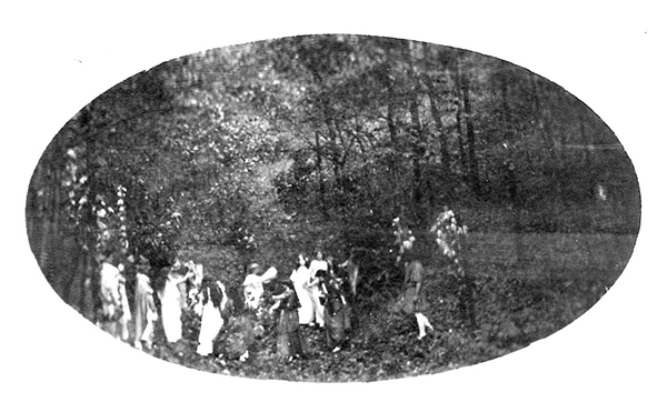 Historic photograph of a fairy ring dance performance at the Indiana Dunes, from the Jens Jensen Archive, used with permission from the Sterling Morton Library, The Morton Arboretum. Jens Jensen organized 'The Pageant of the Year and Play Festival' (1915) located in Chicago's legendary Garfield Park that was among the many outdoor festivals he often orchestrated to create awareness of endangered regional landscapes. At one event, nearly 1,400 costumed children and adults participated in telling a story of the changing seasons of the year for an outdoor audience of 25,000 people.