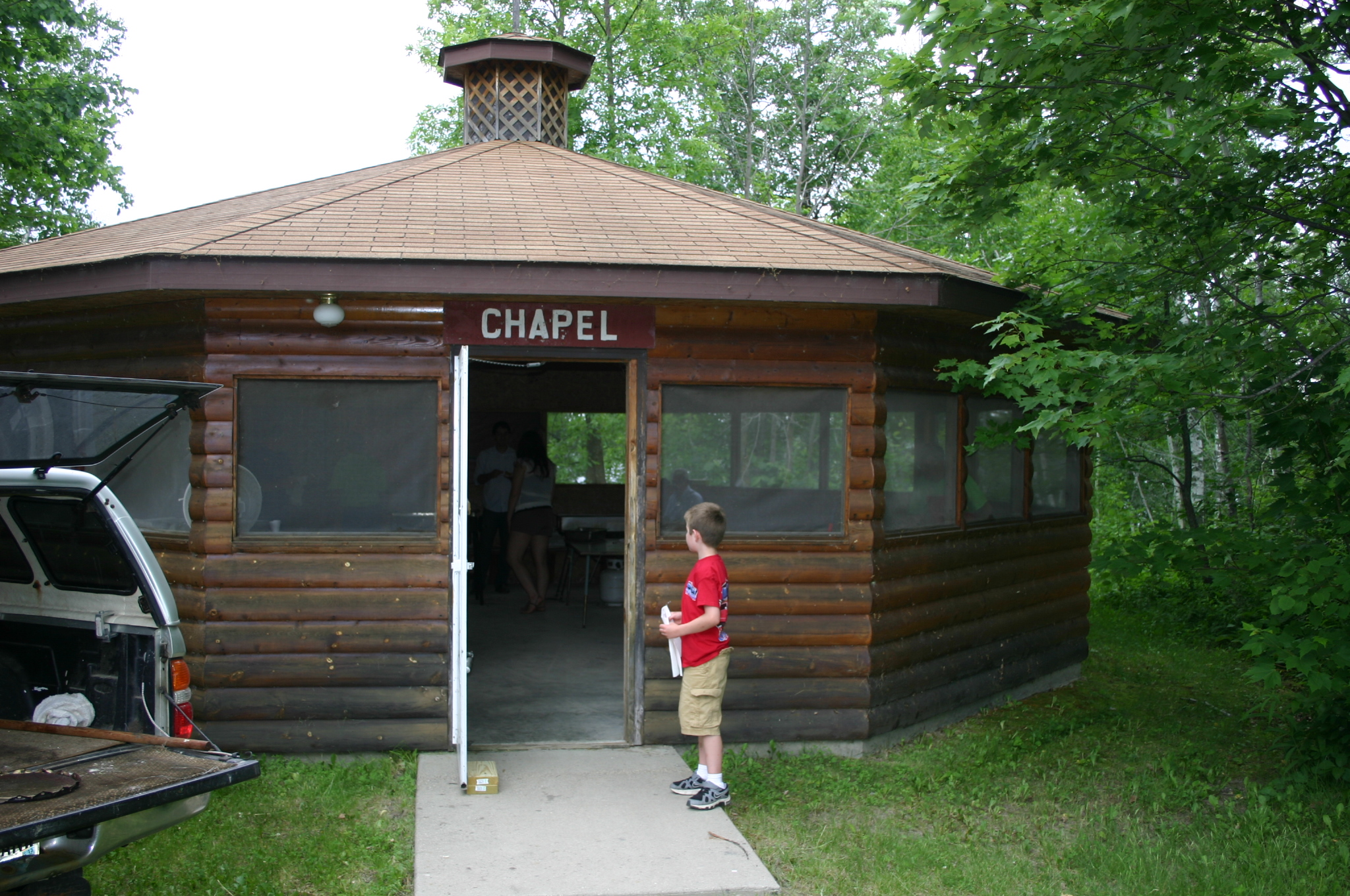 Chapel - The chapel is a screened gazebo with benches lining the inside perimeter. Extra chairs and tables can be brought in to facilitate the use for small group meetings.
