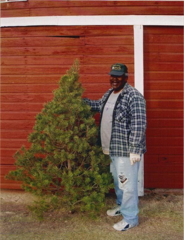 Tom Wellington with selected Christmas Tree