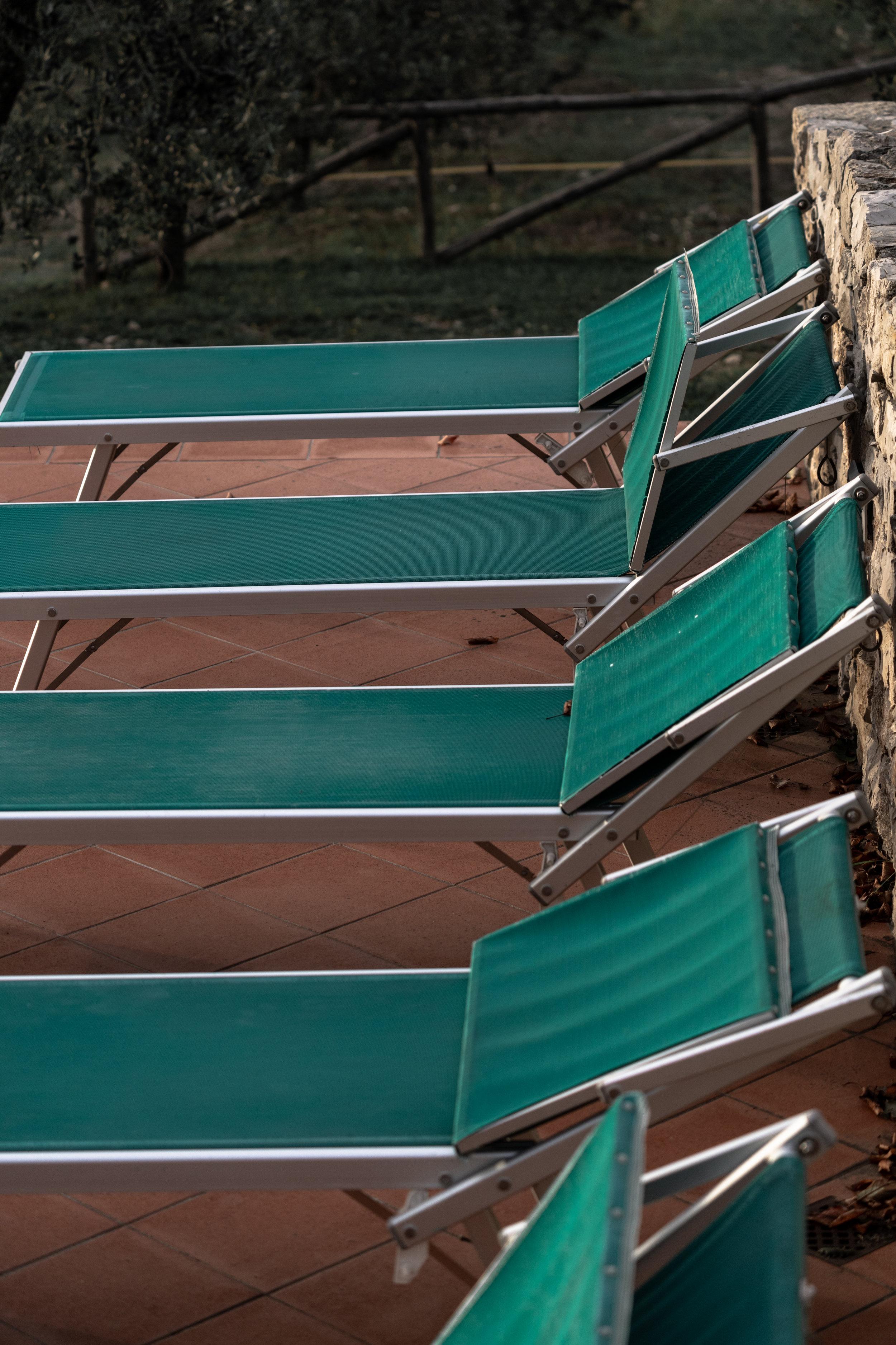 Pool chairs awaiting summer at Castello Di Meleto