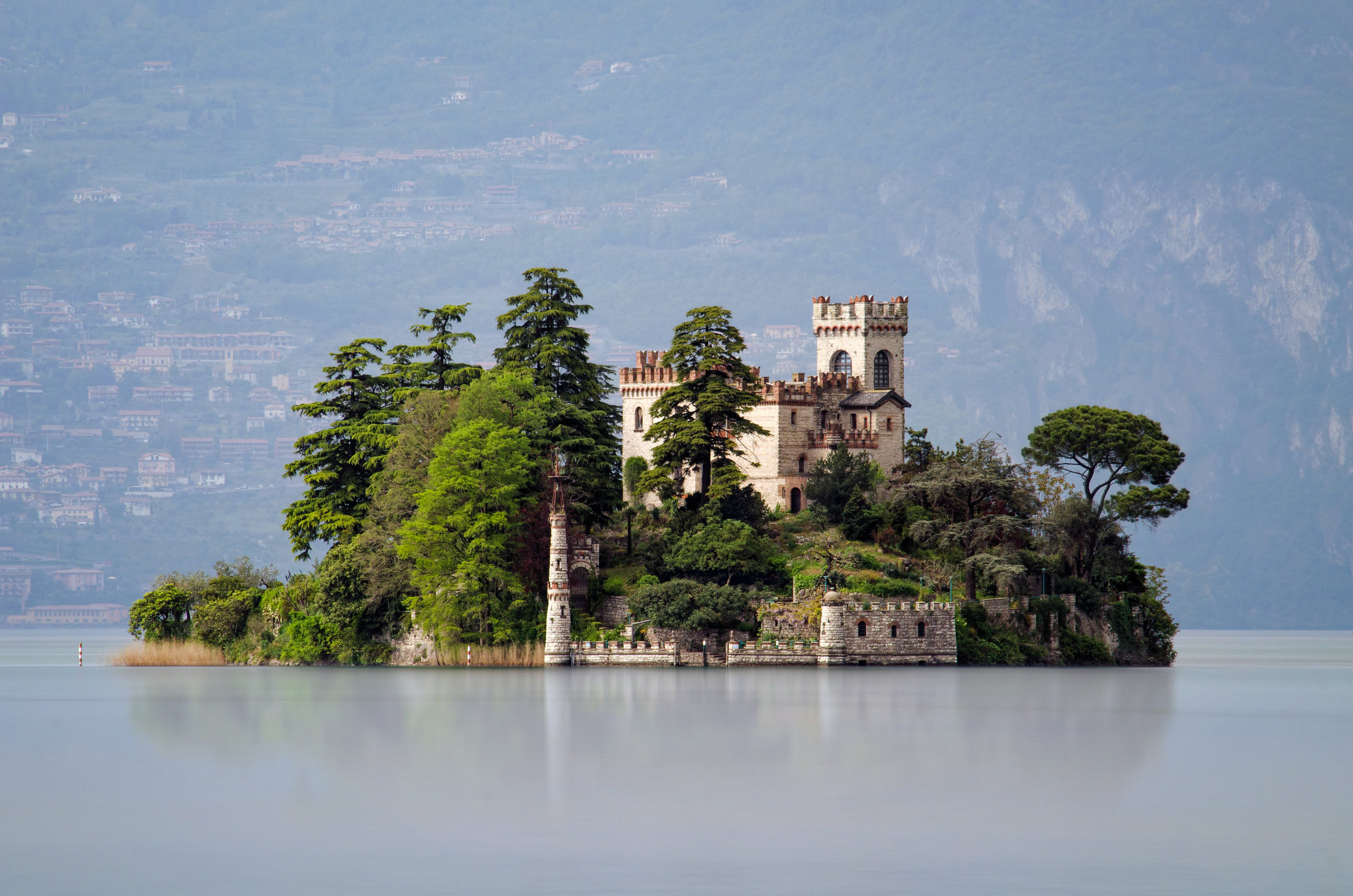 Little island Isola di Loreto on Iseo Lake, Italy