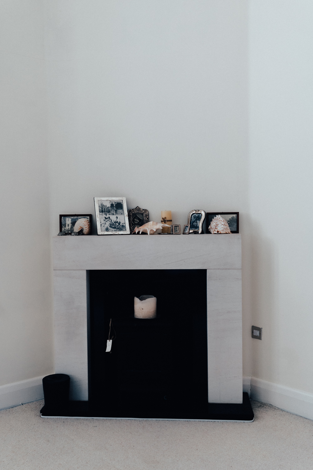A mantelpiece full of family photos and precious objects, an all time favourite.