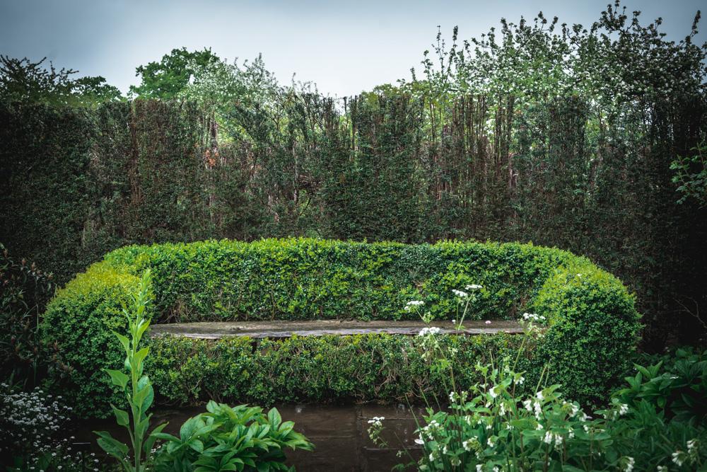 Sissinghurst-Castle-Garden-Bench-covered-by-Ivy.jpg