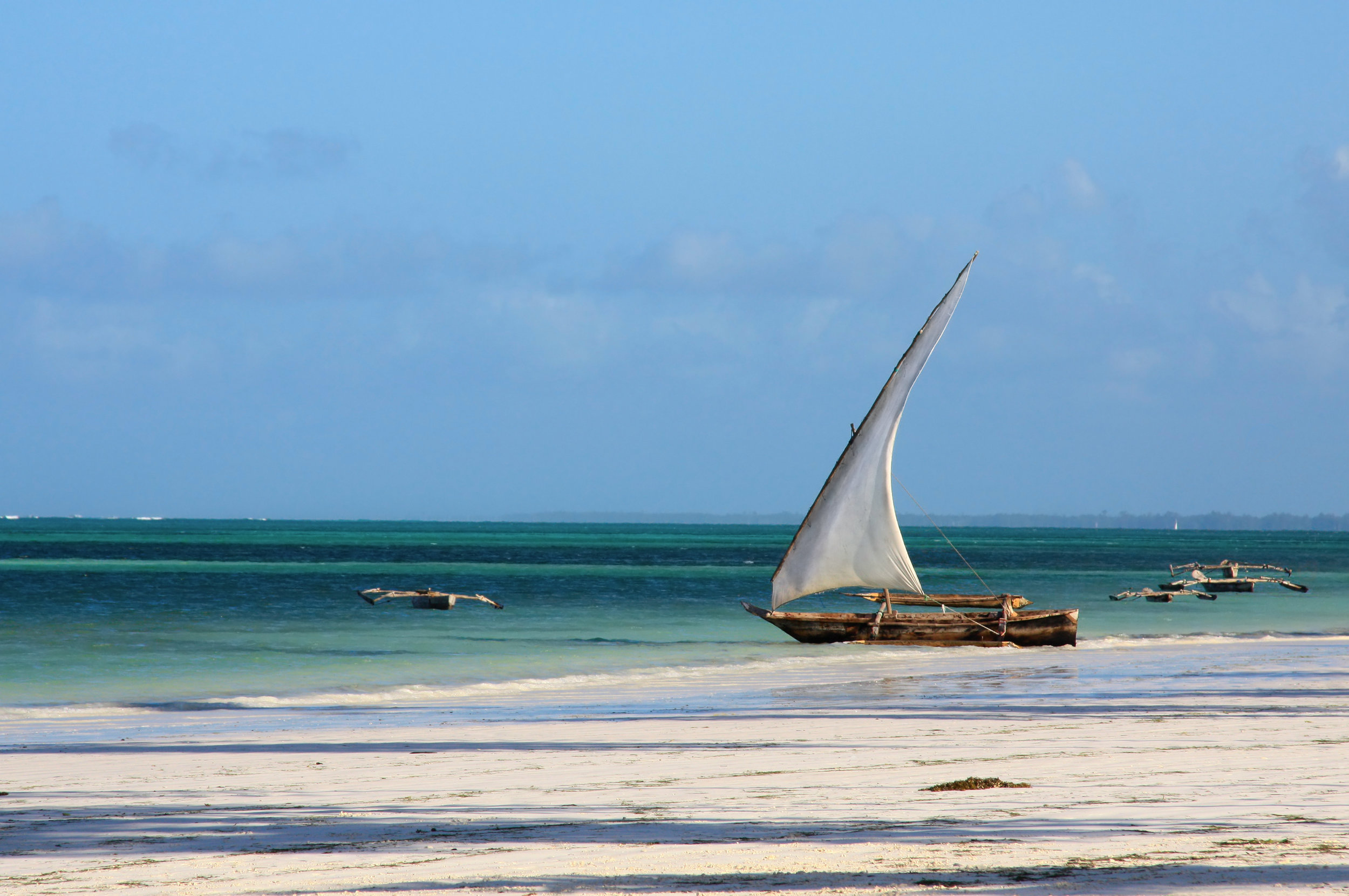 traditional central African fisherman sailboat on beach