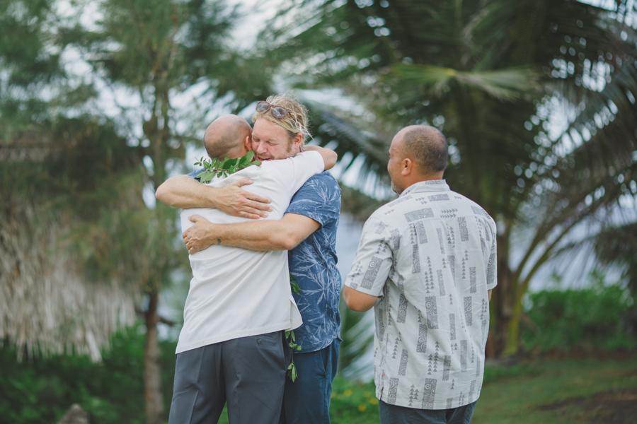 groom hugs