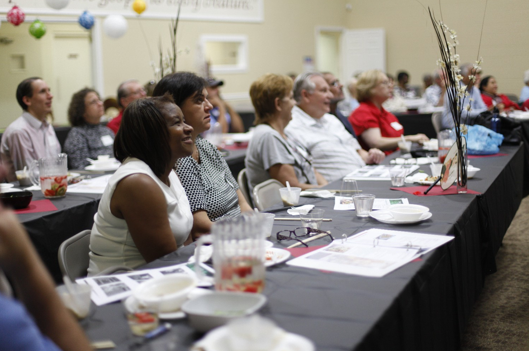 The audience enjoys a Dinner with the Doctor presentation at the East Ridge SDA Church.