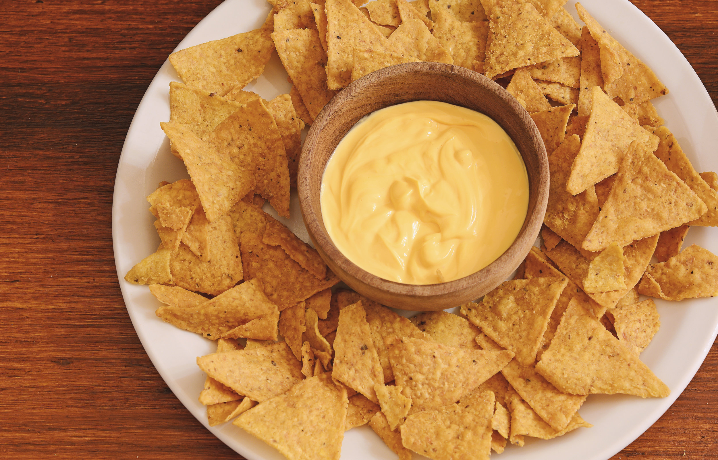 Top-view-of-nachos-with-cheese-dip.jpg