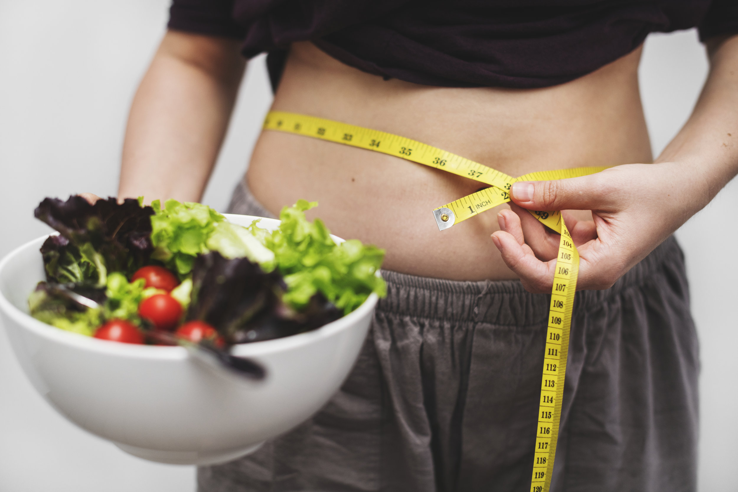 Woman-measuring-her-tummy-and-weight.jpg
