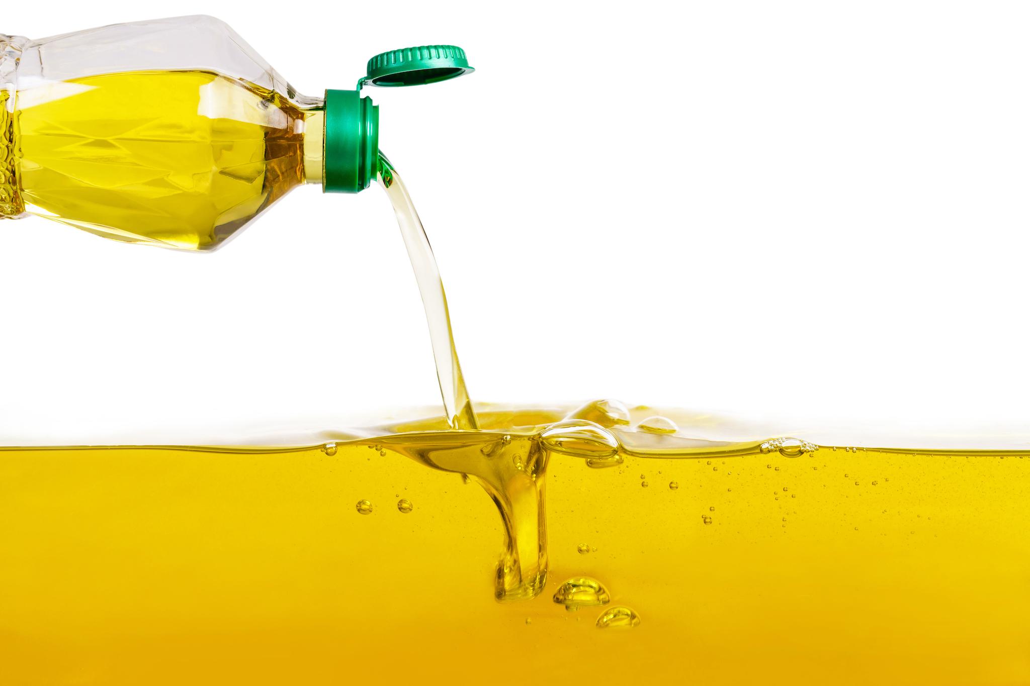 Vegetable-oil-pouring-on-vegetable-oil-background.jpg