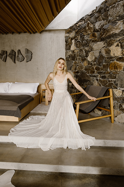 An ivory chiffon gown with metallic leaf embroidery by L'eto bridal
