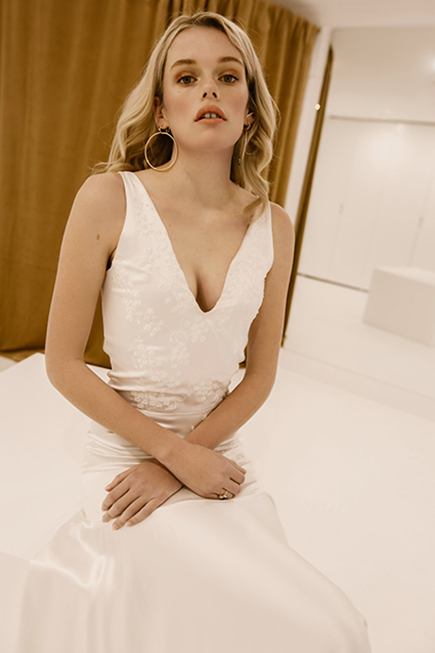 With a tight fit and modern silhoutte, our 'Piece 9' wedding dress is sure to make you swoon. Discover L'eto's take on the contemporary, artful bride. View now.