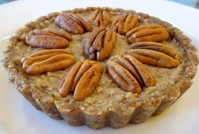 Raw Pecan Tart  By Food to Live  For the crust:  Some extra virgin olive oil or coconut oil to grease 2 tart pans 3/4 cups activated  walnut pieces  4 teaspoons dried, shredded, unsweetened coconut  1/4 teaspoon sea salt 1/4 teaspoon ground cinnamon 3 large pitted Medjool dates 4 teaspoons ground flaxseeds  For the filling: 10 large Medjool dates, pitted and soaked for 1 hour  Reserve date soak water 1/3 cup activated cashews  2 teaspoons fresh lime juice 1/2 teaspoon vanilla extract 1 teaspoon unrefined virgin coconut oil - softened/melted 1/4 teaspoon sea salt - 20 activated pecan halves  INSTRUCTIONS:  1. You'll need two 4 1/2 inch tart pans with removable bottoms. 2. Oil the insides of each tart pan with extra virgin olive oil or coconut oil. 3. To make the crust, place Activated walnuts, coconut, salt and cinnamon in a food processor with an S blade. Process until crumbly. 4. Add dates and ground flaxseeds and process until the mixture begins to stick together. 5. Divide mixture among the two tart pans and press firmly into the bottom and up the sides of the pans. You can use your fingers or the back of a teaspoon. (No need to clean the food processor, you'll be using it again). 6. To make the filling, drain the soaking dates reserving the soak water. Drain and rinse the cashews. 7. Place the dates, cashews, lime juice, vanilla extract, coconut oil, and sea salt in the food processor and process until smooth, scraping down the sides often. If it is too dry, add 1 tablespoon of the reserved date water but only if needed. Save the rest of the date water to sweeten your morning smoothie. 8. Pour into the crust filled tart pans with the date filling. 9. Top each tart with 10 pecan halves. 10. Refrigerate for several hours. Carefully push tart up and remove side pan. You can serve tarts on their removable disk or carefully try to remove it. 11. Cut each tart into segments and serve as is or with whipped coconut cream. #tart #desserts #healthydesserts #rawdessert #pe