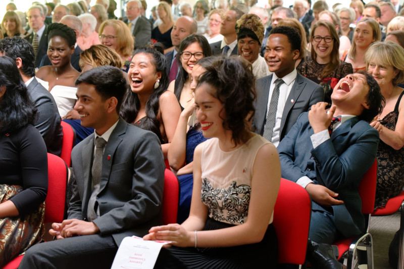 Student laughing at graduation ceremony