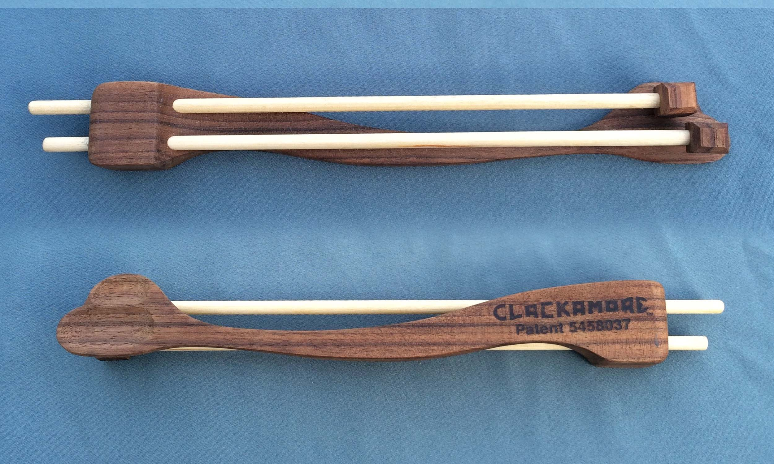 Double . While some success has been realized with double hammer Clackamores none has ever been offered for sale. This Walnut wood model has two spoon cuts and does make slightly different tones with the two hammers.