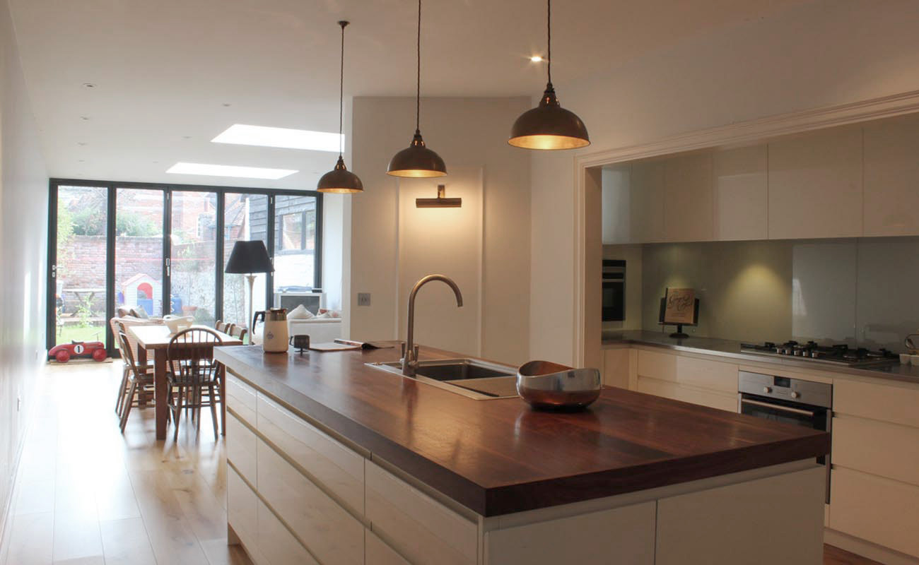 White & walnut handleless kitchen with solid walnut & stainless steel worktops