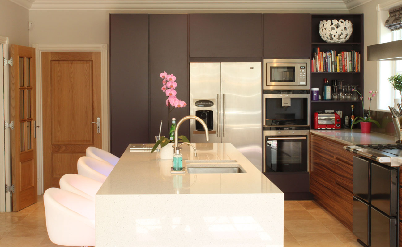 Modern, handleless, purple kitchen with zebrano veneer & quartz worktops