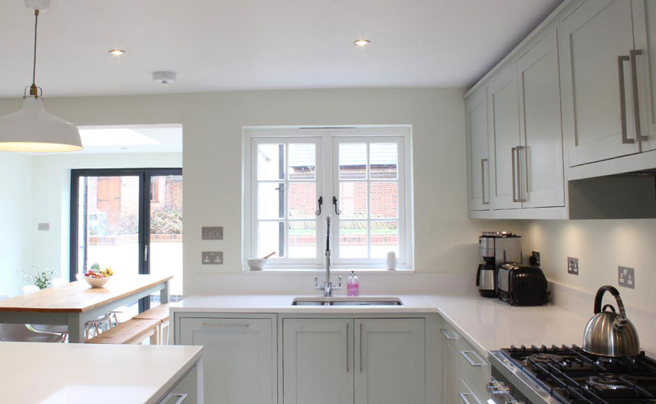 Shaker kitchen in Farrow & Ball Mizzle with quartz worktops