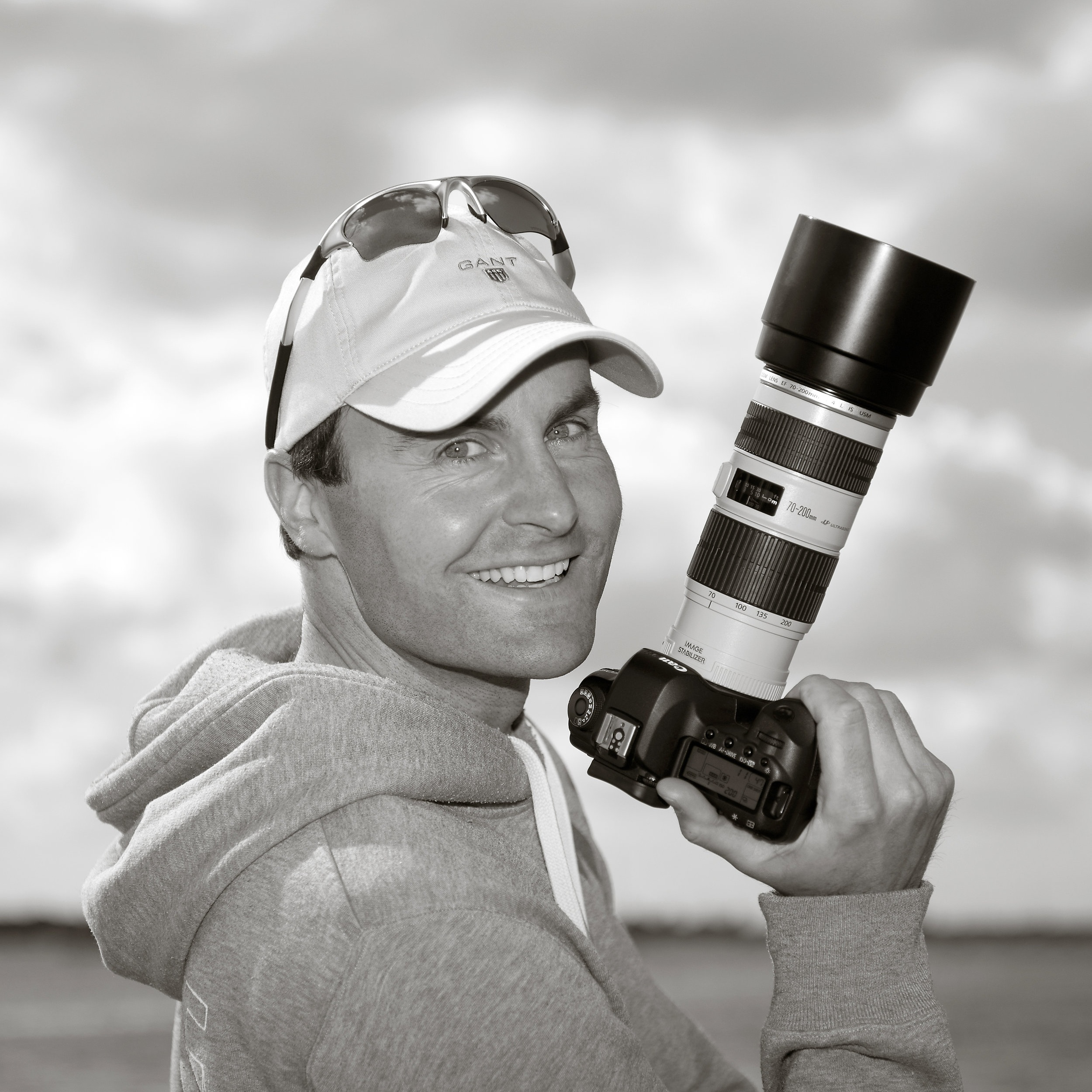 """luke whitaker - FOUNDER & TUTORLuke is an English photographer and gallery owner with a love of the sea who lives and works in the beautiful waterside village of Bosham, on Britain's south coast.He is hugely passionate about photography's growing position within the art world and in 2012 he set up a photographic gallery on Bosham's historic waterfront specialising in marine, landscape and wildlife photographs.Luke has a keen eye for what sells and why, and personally represents some of the world's leading photographic artists. He has an established record of running successful exhibitions that frequently outsell the London galleries, and has developed a growing list of collectors on the south coast.Luke has always been drawn to the sea and his personal work is dominated with coastal views and English seascapes. """"I try to capture some of the rhythm and timeless beauty of Britain's coastline that has remained unchanged for centuries"""".Luke was educated at King's College School in Wimbledon and Cambridge University. He lives in Emsworth with his wife Sally and their two children. Outside of photography, his dream ambition is to own a small fishing boat and catch seabass within Chichester Harbour."""