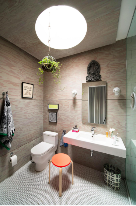 An existing small, square skylight in the master bathroom was made more dramatic when Mr. Salasky dropped the ceiling and carved a larger, circular opening into it.