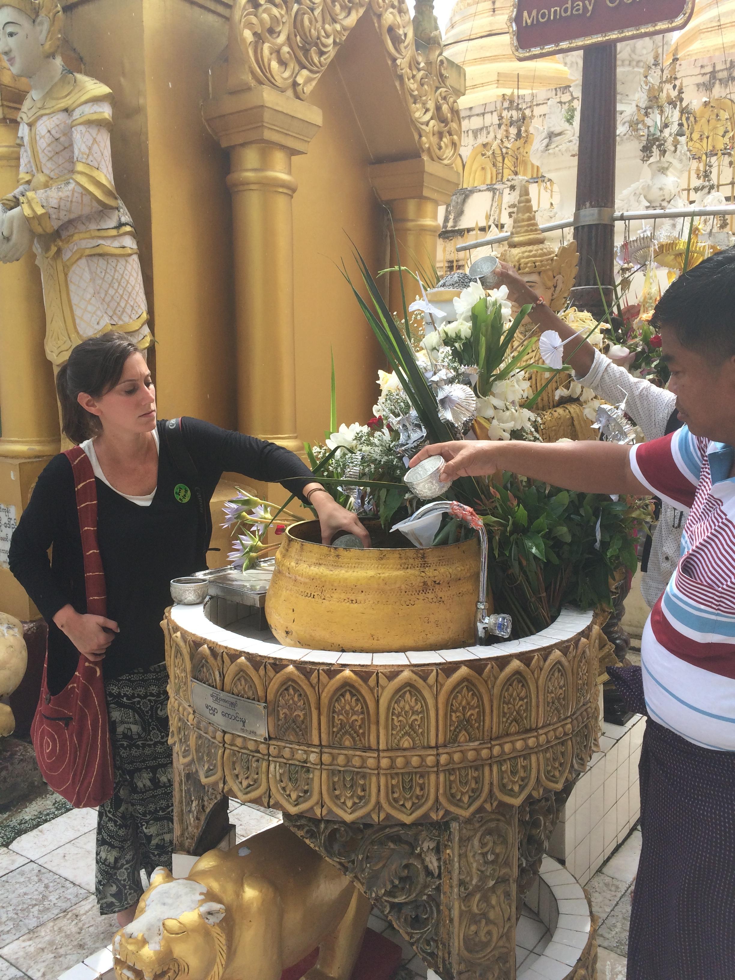 Partaking in rituals at Shwedagon Pagoda in Yangon, Myanmar
