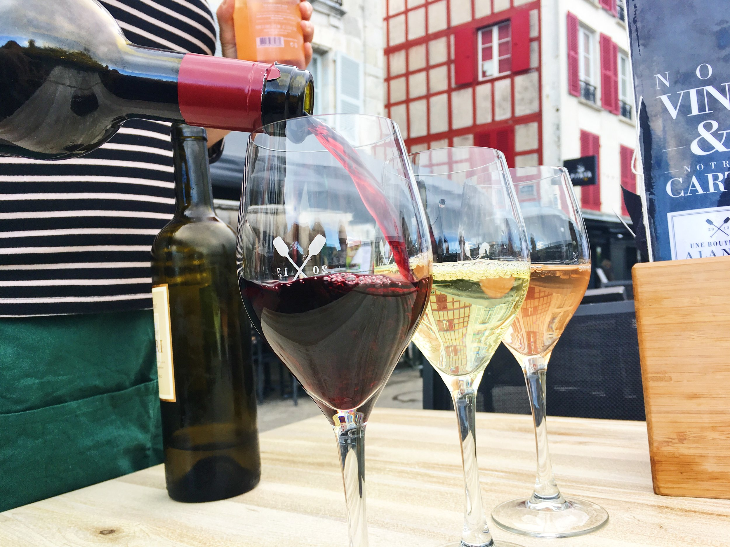 Sharing wine with new friends in Bayonne, France