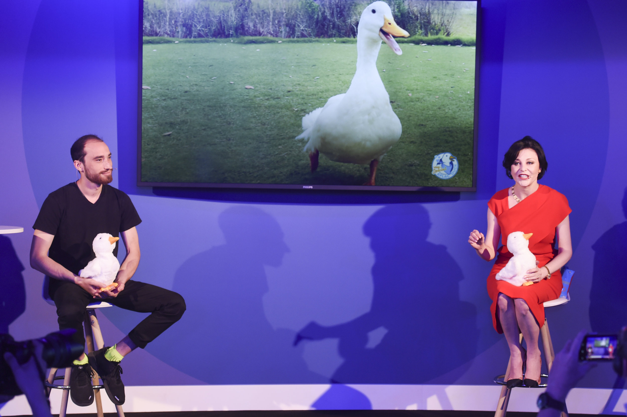 Aaron Horowitz of Sproutel (left) and Aflac's Catherine Hernandez-Blades with the ducks