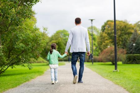 51385187_S_father_daughter_girl_man_walking_strolling_pavement_summer_feet_legs_shoes.jpg