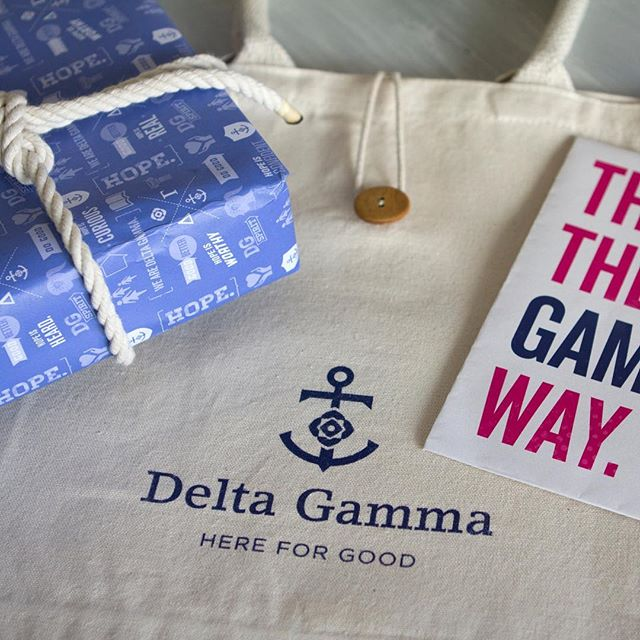 Brand kit and swag for the Delta Gamma brand. Custom wrapping paper design with rope-tie (a symbol of the bond of sisterhood) and canvas bag design. #megrusselldesign