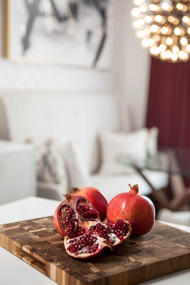 pomegranate-on-wooden-cutting-board