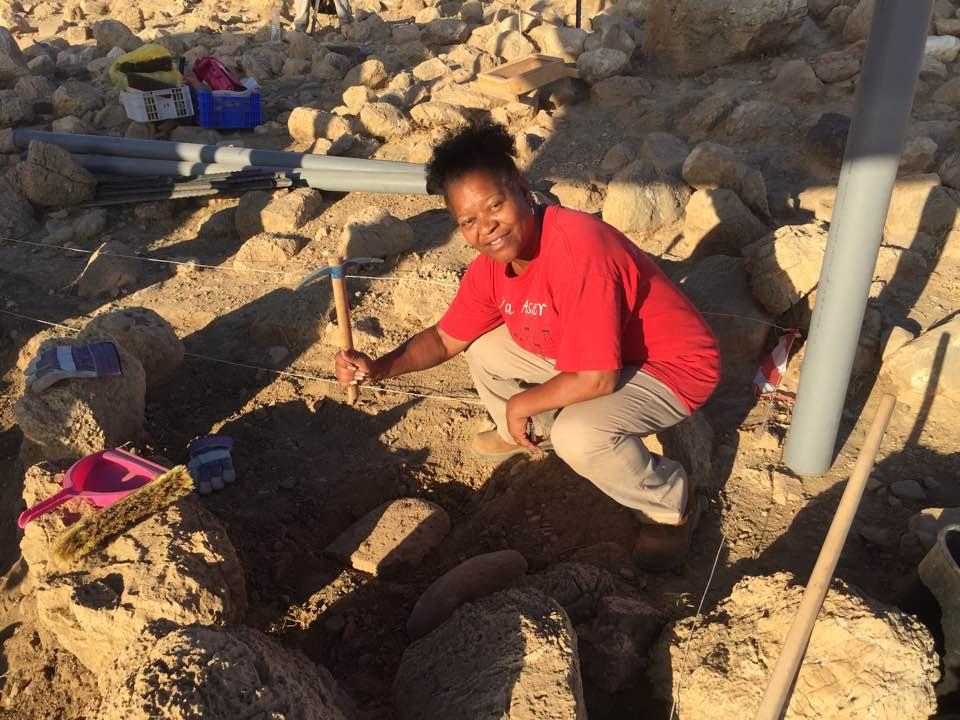 Yaminah poses where she found a grinding stone (Kh. el-Mastarah June 2017).jpg