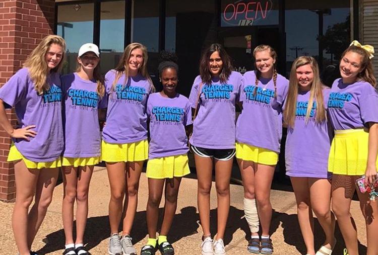 girls tennis team wearing matching shirts