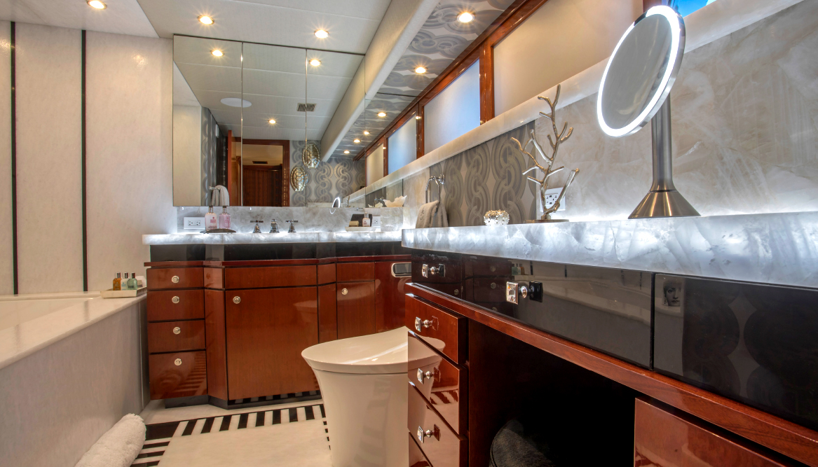 The new Hers Master Bath features a clean design and outstanding use of wood and marble to create a cozy interior and a spot of superyacht-paradise. The quartz-lit vanities add a spectacular flair.
